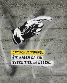 """""""Excuse me, there's a dead animal in your meal..."""" #veganstreetart by #fjodorrr, // """"Entschuldigung, Sie haben da ein totes Tier im Essen...""""  #govegan, #stencil, #adbusting,  #vegan, #streetart, #stencils, #graffiti, #streetart, #carnism,"""