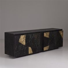 A Paul Evans Argente Four Door Cabinet with Black and Gold design http://decorationlovers.com/