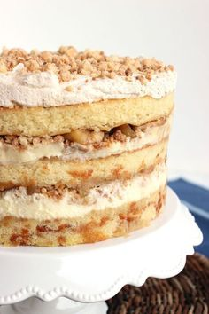 Buttery cake, apple pie and cheesecake.all mashed up into one incredible dessert! Apple Pie Layer Cake - Inspired by the same cake from Milk Bar in NYC.this Apple Pie Layer Cake has a little bit of everything for everyone! Apple Desserts, Holiday Desserts, Apple Recipes, Cupcakes, Cupcake Cakes, Layer Cake Recipes, Dessert Recipes, 2 Layer Cakes, Fall Cake Recipes