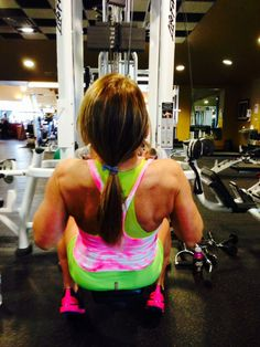 Kim Hyman is adding a splash of color to the gym in her Hard Tail shorts and tank @Bodies by Leigh