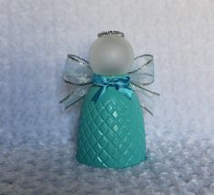 This light blue Christmas angel is repurposed from a ceiling fan light shade. It is accented with silver ribbon wings, glass ornament head, and blue bow. Glass Light Globes, Ceiling Fan Globes, Glass Light Shades, Glass Globe, Ceiling Fans, Blue Christmas, Christmas Angels, Christmas Crafts, Snowman Crafts