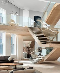 Soho Loft in New York by Gabellini Sheppard Associates. #design #interiordesign #interiordesignmagazine #staircase #apartment #wood @gsassociates