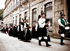 PONTEVEDRA, SPAIN - AUGUST 10: A typical Galician pipe band through the streets of the old town in celebrating the festival of The Pilgrim, August 10, 2008 in Pontevedra, Spain.