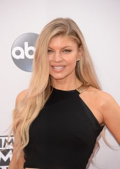 Fergie owns her super-thin brows, which are sandy-hued just like her long hair. - MarieClaire.com