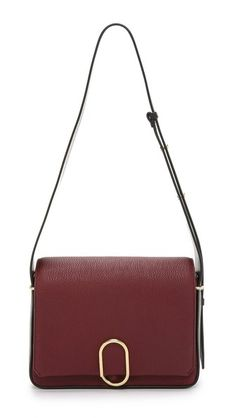 A rich leather 3.1 Phillip Lim handbag with a unique brass clasp in front. Magnetic back pocket and angled, button-adjustable shoulder strap. - 3.1 Phillip Lim Alix Flap Shoulder Bag