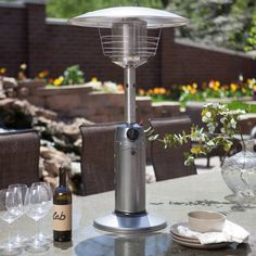 AZ Patio Heater Portable Gunmetal Tabletop Heater - Dining outdoors doesn't have to be limited by the seasons when you place the AZ Patio Heater Portable Silver Tabletop Heater as your centerpiece. This...