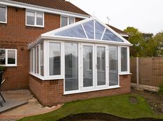 White PVCu DIY Gable-Front Conservatory, Dwarf-Wall Model. Manufactured and supplied by ConservatoryLand DIY Conservatories. Photo kindly supplied by our customer.