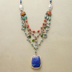 TIERED LAPIS NECKLACE�--�Three tiers, each distinct, form a rich backdrop to Jes MaHarry�s centerpiece lapis set in 14kt gold bezel. The sterling silver and 14kt gold linked strands are peppered with turquoise, mandarin garnet, chrome diopside, carnelian, coral, lapis and rustic sterling silver tabs. Lobster clasp. Handmade in USA. 20L.