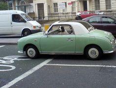 green car, dog driving.Cracks me up! Looks like Dixie!