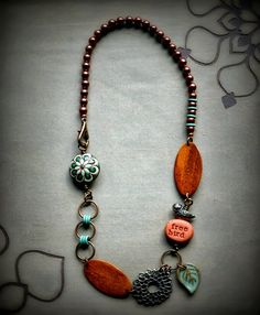 love this woman's jewelry-found on Lorelei's Blog and she also has pieces on Etsy