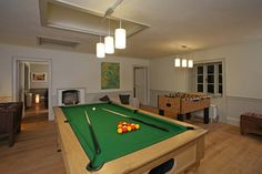Chill out in the games and tv room at Berry House, large country house to rent in Devon