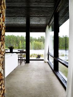 Lundnäs House is a summer house designed by Swedish architect Buster Delin for himself. The Lundnäs House is the architect's summer house. Architect House, Architect Design, Interior Architecture, Interior And Exterior, Contemporary Architecture, Dark Ceiling, Wooden Pillars, Sweden House, Swedish Interiors