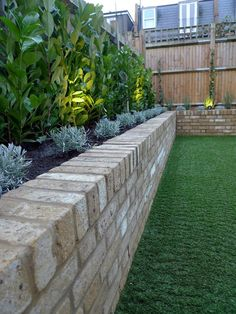 Yellow brick raised bed walls artificial fake easy grass lawn mixed planting herne hill dulwich london - All For Garden Garden Retaining Wall, Landscaping Retaining Walls, Brick Garden, Backyard Landscaping, Garden Grass, Landscaping Ideas, Garden Walls, Brick Flower Bed, Brick Planter