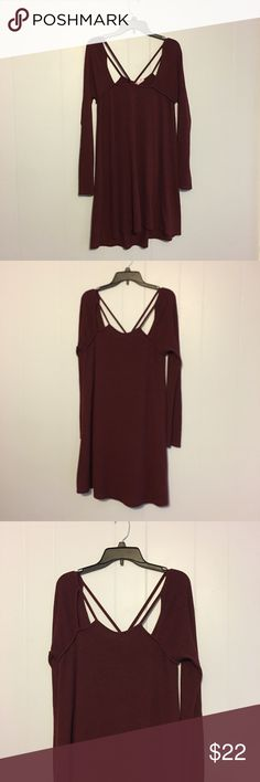 Alya Burgundy Sweater Dress How pretty and perfect is this for fall? Burgundy colored sweater dress with cutouts on the neckline in the front and back. Lightweight and would be great with tights and boots. 37 inches in length and 17 inches armpit to armpit. Alya Dresses