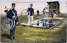"""Early Dutch Folding bicycle 1900s This photo """"Exercising at the obstacle course"""" will be made around 1902. The militia men are wearing parts of a new uniform, introduced in 1900. At left you can see prove that the Dutch Infantry used folding bicycles; allthough officially those bikes were never introduced in the Dutch Army. The bicycle is a Burgers or a Simplex. The Dutch Infantry tested bikes of both brands intensive in the 1900s. The Burgers fold"""