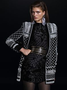 Balmain x H&M dress, with beaded blazer, wide belt and drop earrings.