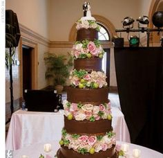 """Besides enthusiastic toasts, the wedding also featured a five-tiered chocolate-on-chocolate cake, with a variety of fillings ranging from amaretto to Oreo, topped with a 1950s-era ceramic bride and groom. """"We made the cake for 300 guests, hoping to take a bunch home, but it was all gone!"""" says the bride."""
