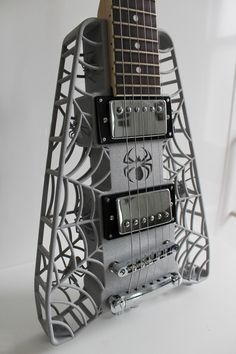 The Spider 3D printed guitar was designed specifically for laser sintering, one of the common 3D printing technologies that allows for the manufacture of full strength, extremely complex parts. The entire body, including all the little spiders inside the body, was printed as a single component, which could not be manufactured any other way.