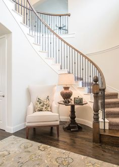 Image result for curved staircase foyer ideas with bench
