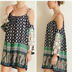 Entro Black & Green Paisley BOHO Crochet Tunic L BRAND SPANKING NEW! No tags, purchased from another Posh Seller, doesn't fit me right. Entro Black & Green Paisley BOHO Crochet Tunic in Size Large. FEATURING COLD SHOULDER, CROCHETED SLEEVES. STUNNING! RETAIL $79.00 BOHO Tops Tunics