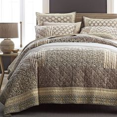The Laura Patchwork Quilt displays traditional woodblock prints, tribal ikats, stripes, and damask medallions. A great year-round layer.