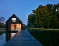 A contemporary new lake house was constructed within a tranquil lake setting using slim frame sliding glass doors from IQ on the focal elevations.