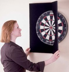 Deluxe Dartboard Folding Wall Protector by Deluxe. $31.95. Are you or your friends not always on target whenyou are playing darts? Is your wall looking like Swiss cheese?Protect your wall with this wall protector. It fits snugly around yourdart board and looks great as it borders your dart board.Product Features: Slips easily over any mounted, standard 18 bristle dartboard Protects wall from stray darts Durable, lightweight, polystyrene and hardboard constructi...