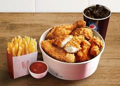 KFC U.K. Mighty Bucket for One, a combo meal that includes a mini bucket filled with two Mini Breast Fillets, two Hot Wings, and two pieces of Original Recipe Chicken.