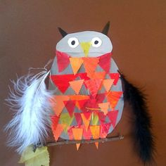 2nd Grade - Tint & Shades, painted gray paper in shades and tints, and orange, red, yellow with tints and shades. Cut up to make collage owl.  Added feathers and stick