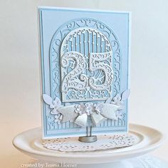 Teresa Horner for www.amazingpapergrace.com using Filigree Numbers, Ornamental Arch and Petite Double Bow
