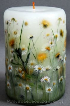 candle with daisies, dandelions and grass, big