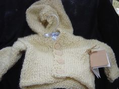 So sweet handmade hooded sweater. Lots of colors and sizes! Made by Baskets, Beads, & Baubles in South Dakota.