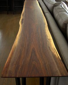Walnut Sofa table with black powder coated Aluminum legs in its new home in Brighton MI. #wood #woodwork #woodcraft #handmade #handcrafted #hardwood #walnut #blackwalnut #treegang #arborgang #custom #furniture #coffeetable #liveedge #naturaledge #slab #slablife #slabsfordays #puremichigan #madeinusa #madeinamerica #madeindetroit #reclaimed #repurposed #treepurposed @treepurposed de jaosin