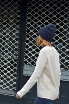 such a cute view of her hair poking out from behind. like the put-togetheredness of the navy beanie with well-fitting cozy sweater. would be super cute with acid washed cropped jeans