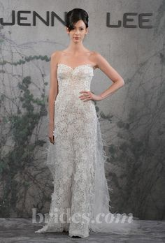Brides.com: Jenny Lee - Fall 2013 Style 1318, strapless lace mermaid wedding dress with floral accents and a tulle and feather train, Jenny Lee  See more Jenny Lee wedding dresses in our gallery.Photo: Steve Eichner