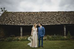 Image by John Day Photography - Classic Cotswolds Wedding At Temple Guiting Manor & Barns With Bride In Bespoke Blush Gown By Jenny Lessin With Bridesmaids In Mink And Groom In Blue Suit By Beggars Run With Images by John Day Photography