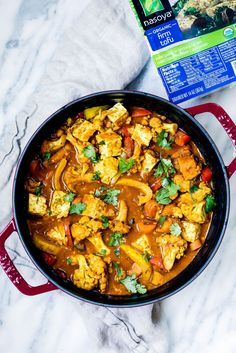 Tofu, Cauliflower, sweet potatoes, bell pepper, garlic, turmeric, ginger and simmer in vegetarian coconut milk based curry dish in partnership with Nasoya Tofu!