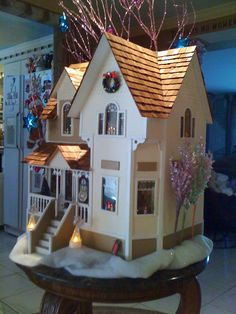 Miniature dollhouse decked out for the holiday...