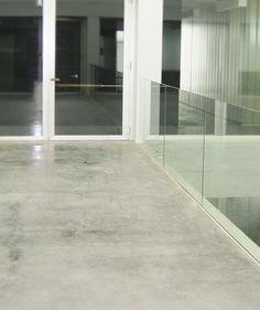 Light reflection in a outdoor terrace surrounded by a glass parapet. #nuvolato #floor #concrete www.isoplam.it