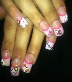 Baby shower nails. The bottle and rattle are cute! It would look better if the nails were a fade.