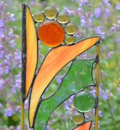 Stained Glass, Stained Glass Yard Art, Garden Sculpture, Garden Decor, Home Decor, Choice of Garden Stake or Hanging Panel, 'Spring Bouquet' by WindsongGlassStudio on Etsy https://www.etsy.com/listing/151901524/stained-glass-stained-glass-yard-art