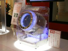Transparent washer or dryer. I like.