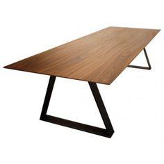 """Table de salle à manger rectangulaire au visuel """"ultra fin"""" """"aile d'avion"""" qui résulte d'une prouesse technique : Le plateau de 4 cm d'épaisseur s'affine progressivement pour atteindre une épaisseur de 5 mm sur les 10 derniers centimètres bordant le plateau. Les pieds de cette table de salle à manger sont en acier brut traité et vernis extra-mat.  Le plateau est disponible en placage de noyer (photo) ou dans des finitions unies."""