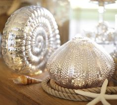Mercury glass shells shimmer beautifully on the mantel.