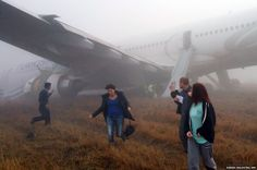 Passengers walk away from a Turkish Airlines plane