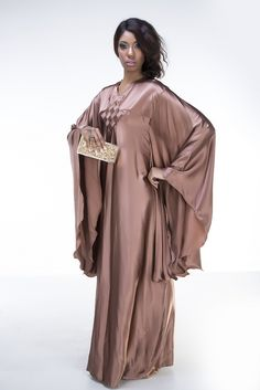 Shimmering Sands Abaya is tailored using silk and comes with a matching hijab also tailored using silk. Fabrics: Silk Colors available                          Silk Satin Dress, Satin Dresses, Gowns, Modest Fashion, Hijab Fashion, Satin Lingerie, Islamic Fashion, Africa Fashion, Modest Dresses