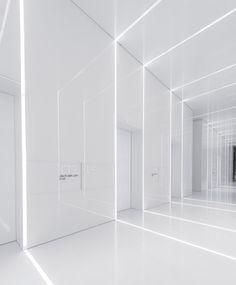 All-white corridor. Soho Fuxing Plaza by Aim Architecture.