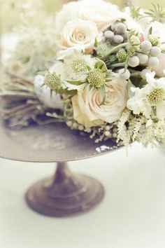 Like this color pallet with blush pinks, gray, green and ivory....