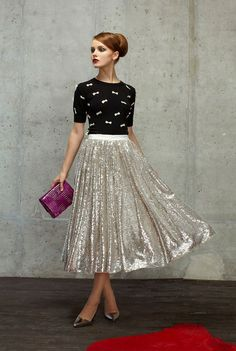 Shop this look for $96: http://lookastic.com/women/looks/black-and-white-crew-neck-sweater-and-silver-midi-skirt-and-purple-clutch-and-silver-pumps/2605 — Black and White Embroidered Crew-neck Sweater — Silver Pleated Sequin Midi Skirt — Purple Leather Clutch — Silver Leather Pumps