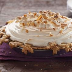 Sweet Potato Coconut Pie with Marshmallow Meringue Recipe -- My grandmother's sweet potato casserole contains coconut and marshmallows. I thought it would be even better as a pie. —Simone Bazos, Baltimore, Maryland